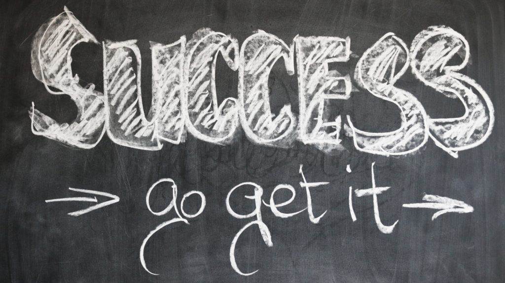 "Blackboard with text ""Success > go get it"""" class=""wp-image-858″/><figcaption><br>Photo by <a href="